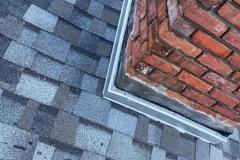 close-up-blue-shingles-with-brick