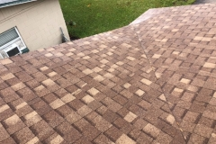 new-tan-roof-after-storm-damnage