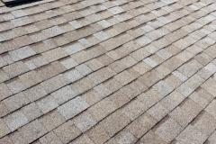 new-tan-shingled-roof